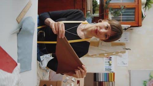 Female Dressmaker Filming Vlog in Sewing Workshop