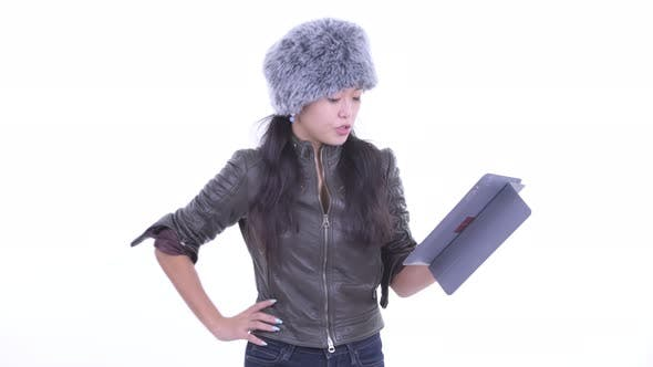 Thumbnail for Happy Beautiful Asian Woman Using Digital Tablet