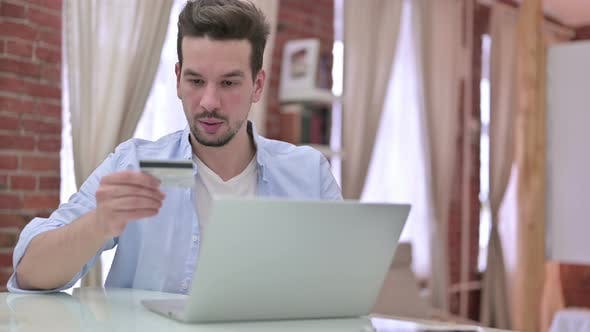 Thumbnail for Online Shopping By Young Man, Using Bank Card