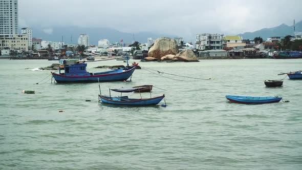 Fishing Boat At Anchor Off Poor Village In Nha Trang