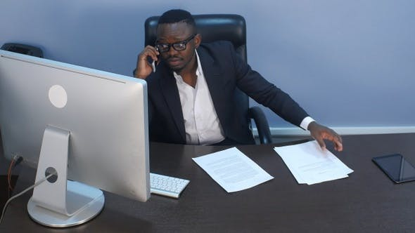 Thumbnail for Pensive young afro-american businessman having a phone