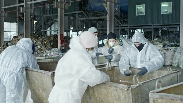 Thumbnail for Workers Sorting Waste at Garbage Recycling Factory