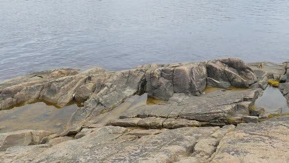 Thumbnail for Large Rocks Along The Shore Showing More Rocks In The Water