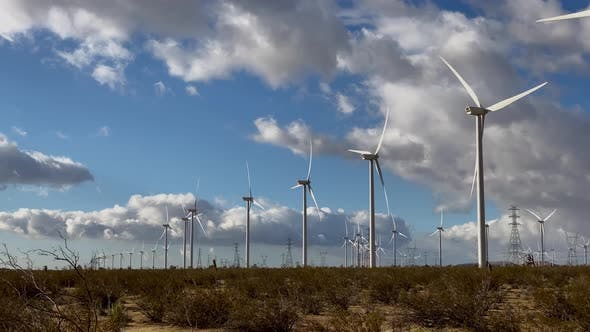 Thumbnail for Driving past massive wind turbines in the California desert
