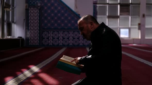 Middle Age Man Read Quran Mosque