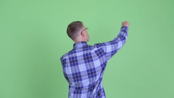 Cover Image for Rear View of Hipster Man Pointing Finger and Directing