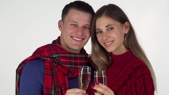 Thumbnail for Young Couple Smiling, Toasting with Their Champagne Glasses To the Camera