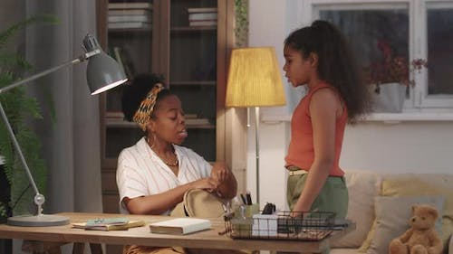 Afro Woman Getting Daughter Ready For School