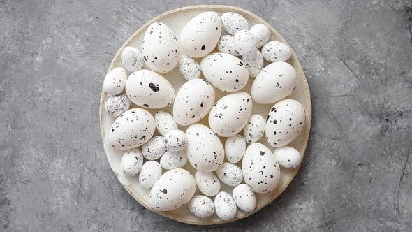 Cover Image for Composition of White Traditional Dotted Easter Eggs in White Ceramic Plate