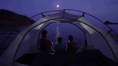 Mom with Children in the Tent at Night