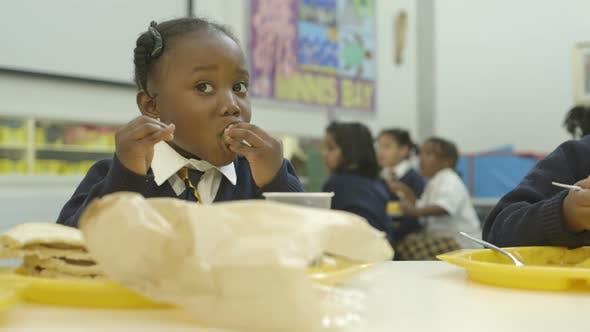 MS Schoolgirl eating in catering