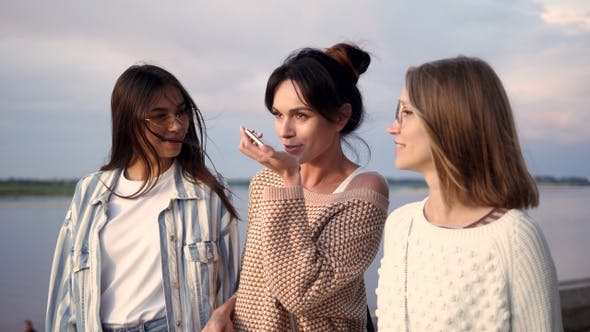 Cover Image for Casual group of girls using smart phone voice recognition