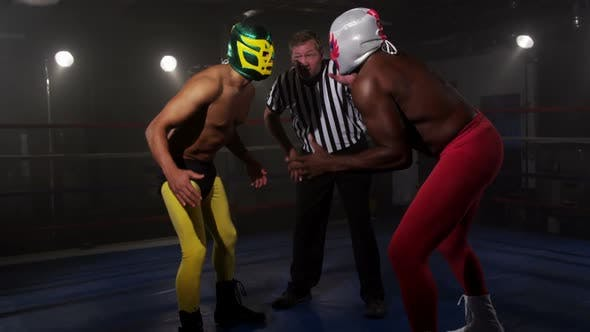 Thumbnail for Masked wrestlers prepare to fight