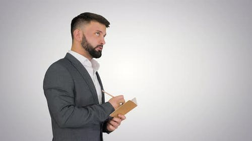 Business Man Writing Down Ideas on Gradient Background