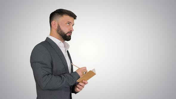 Thumbnail for Business Man Writing Down Ideas on Gradient Background