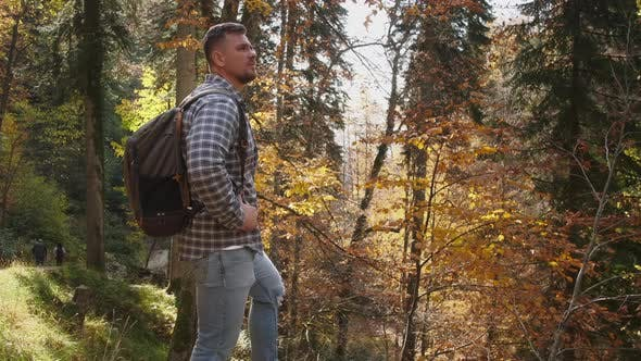 Male Backpacker is Traveling in Natural Reserve