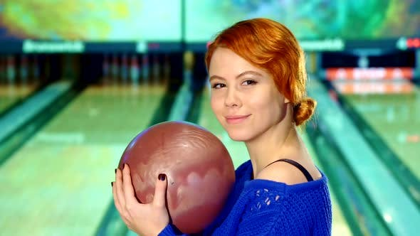 Cover Image for Girl Smiling with Bowling Ball in Her Hands