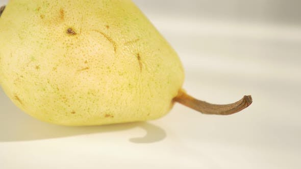 Thumbnail for Pear fruit on white background  4K 2160p UHD panning footage - Beautiful pears on white background