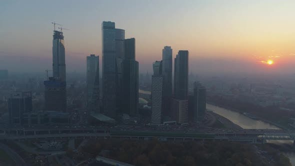 Thumbnail for Skyscrapers of Moscow City Business Center and City Skyline at Misty Sunrise. Russia. Aerial View