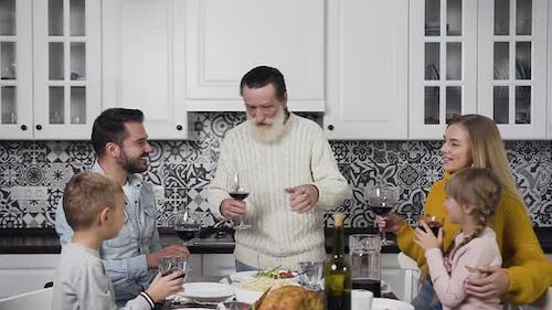 Respected Old Man as a Head of Family Making a Speech at the Thanksgiving Festive Dinner