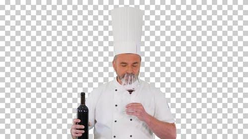 Senior man cook tasting red wine, Alpha Channel