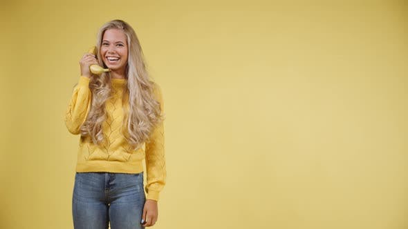 Thumbnail for Caucasian Model Holding a Banana as a Phone Prop and then Ending the Call