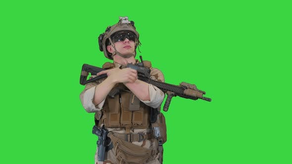 Tired US Marine with a Assault Rifle Standing on a Green Screen, Chroma Key.