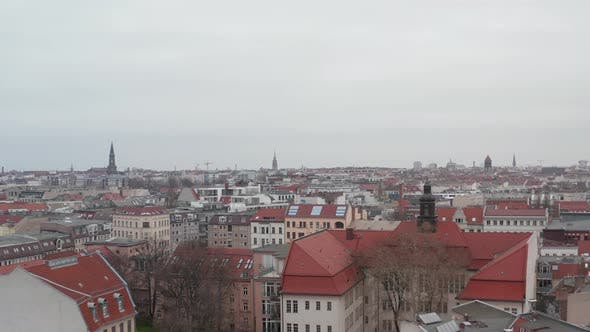 Thumbnail for AERIAL: Slow Flight Over Empty Berlin Neighbourhood with Rooftops During Coronavirus COVID 19 on