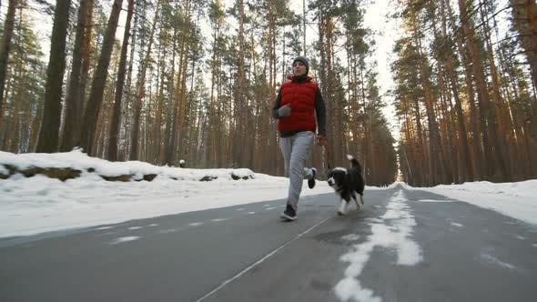 Cover Image for Woman and Dog Jogging on Winter Day