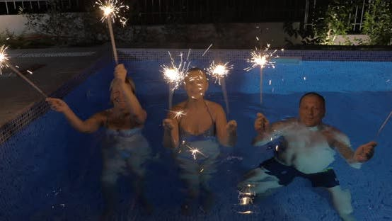 Thumbnail for Celebration with Sparklers in the Swimming Pool