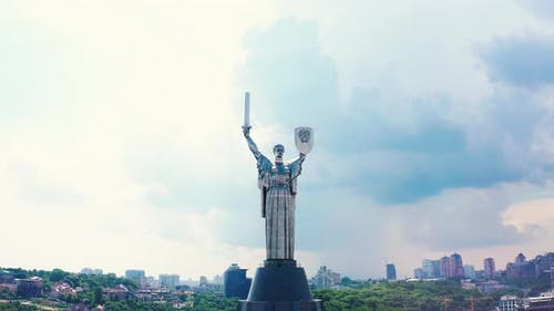 Soviet-era Monumental Statue Motherland with Heavy Clouds on Background