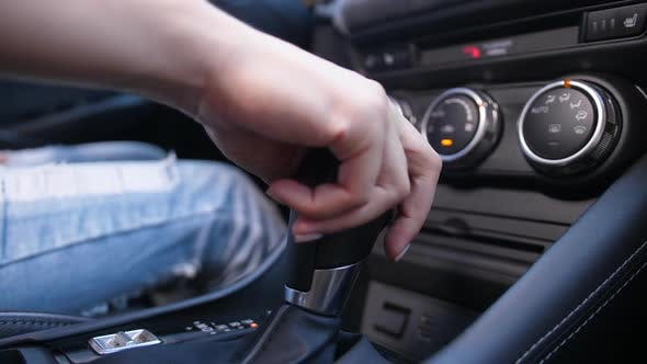 Thumbnail for Hand of Woman Switching Automatic Gearbox in Car