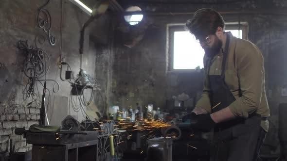 Thumbnail for Professional Blacksmith Sawing Metal