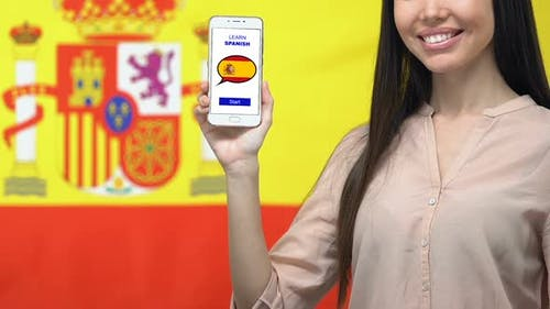 Woman Holding Cellphone With Learn Spanish Language App Online Language Studying