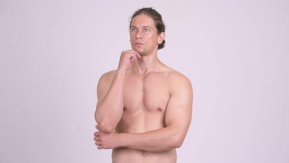 Cover Image for Handsome Muscular Shirtless Man Thinking While Looking Up