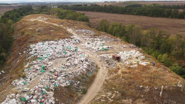 Aerial View of Packed Waste on a Landfill. Employees and Scavengers Are Processing Waste on a