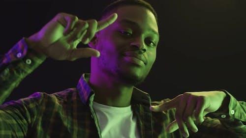 Cool Handsome African American Guy Dancing in Neon Lights Nightclub Atmosphere Slow Motion