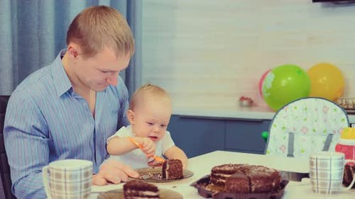 Kid is Trying to Eat the Cake Himself