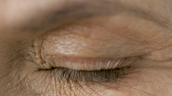 Thumbnail for Close Up of Blinking Senior Woman Eye