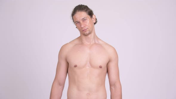 Cover Image for Handsome Muscular Man Shirtless Against White Background
