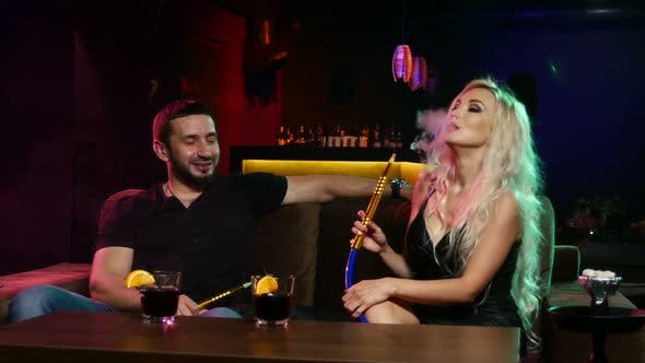Thumbnail for Young Couple Smoking Hookah