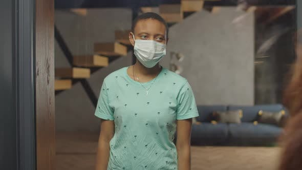 Thumbnail for Black Female in Medical Mask Stay Isolated at Home