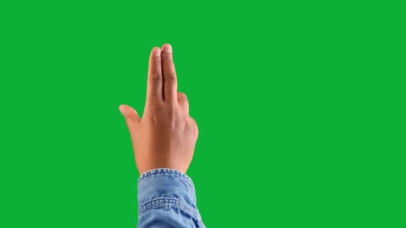 Mixed Race Deep Skin Tone Male Hand Makes a Zoom Gesture on Chromakey Green