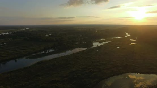 Aerial Sunset Scene of Wood and Wetlands