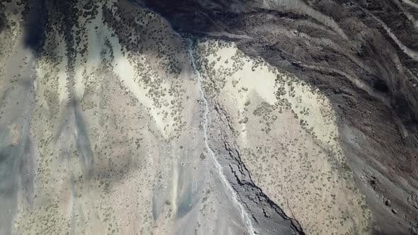 Overhead aerial drone clip over a mountainous barren volcanic area / 6  Full Hd