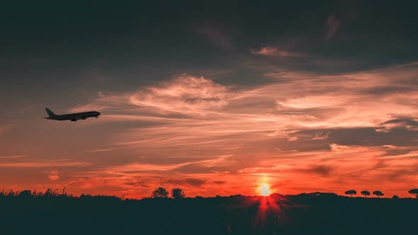Silhouette of an Airplane at Take Off.