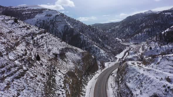 Snowy Mountains and Road in Winter