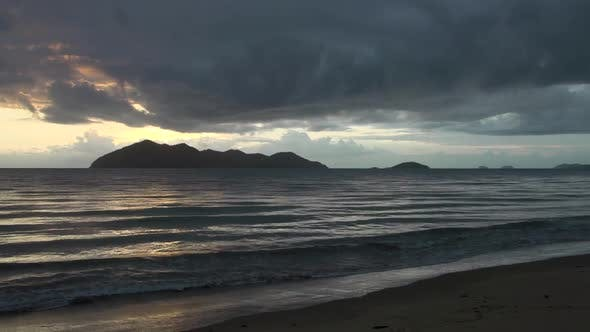 Cover Image for Sunrise time lapse with dark clouds above Dunk Island