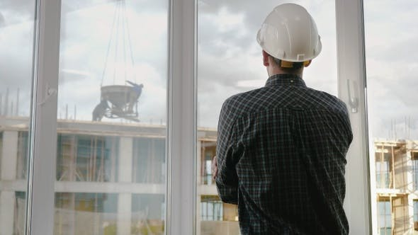 Engineer looking at construction site.