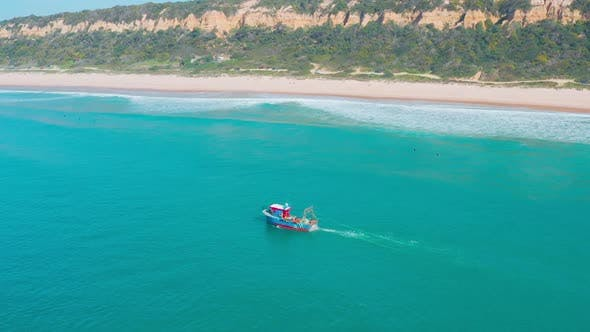 Thumbnail for Fishing Boat Floating on Ocean Waves Near Shore